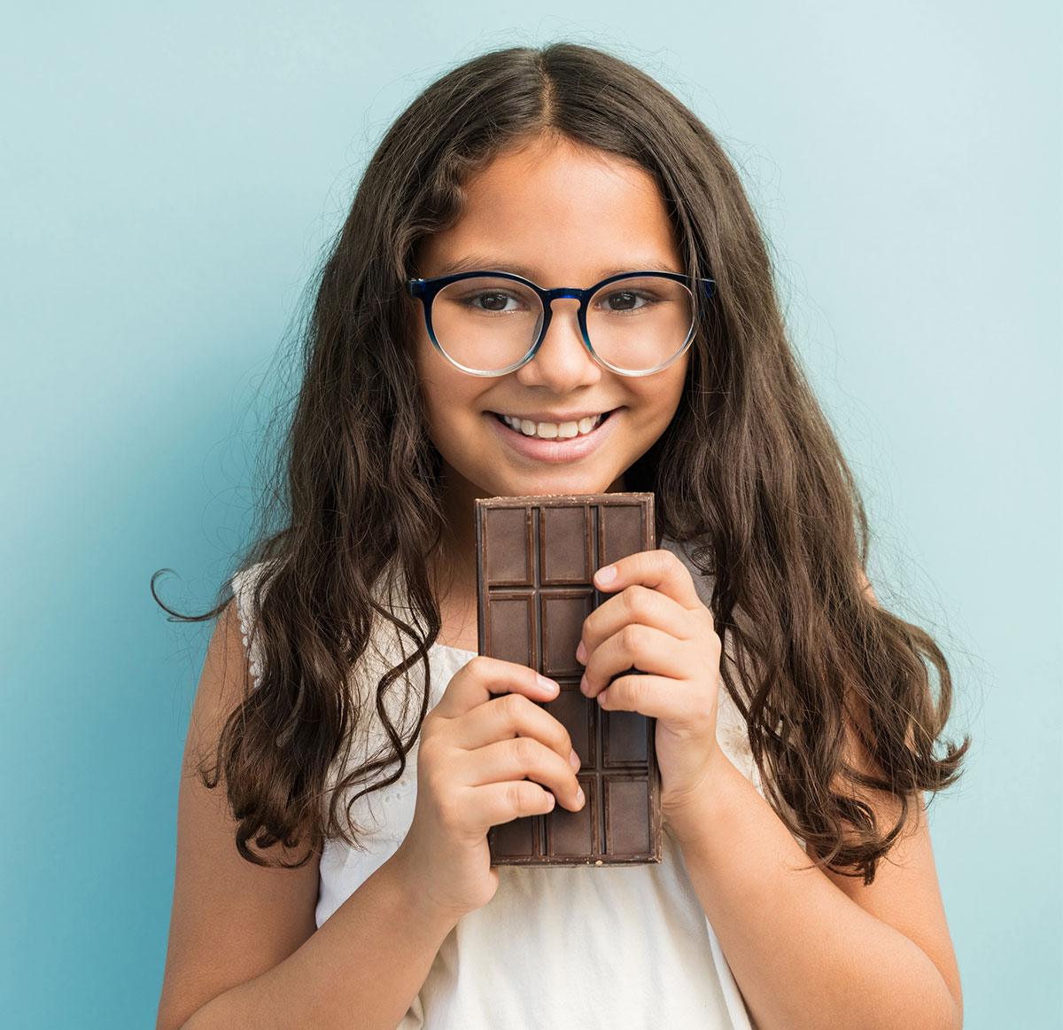 Young girl holding a chocolate bar